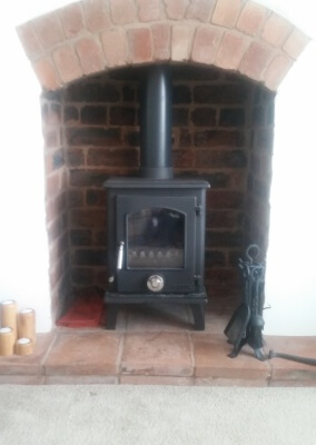 A clean burn multi fuel stove with a quarry tiled hearth and existing arch - Sedgley, Wolverhampton