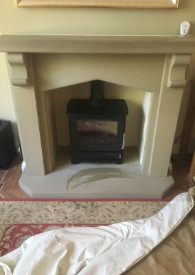 Heta 45 woodburning stove with a  limestone suite & 316 graded stainless steel liner.  Wordsley, Kingswinford.