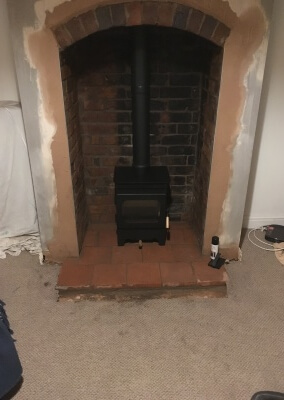Burley Woodburning Stove With A Quarry Tiled Hearth & Original Arch.