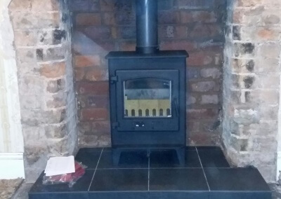 Deans Forge Croft Junior outset multi fuel stove with a 316 grade chimney liner & A Solid Tiled Hearth Stourbridge, West Midlands